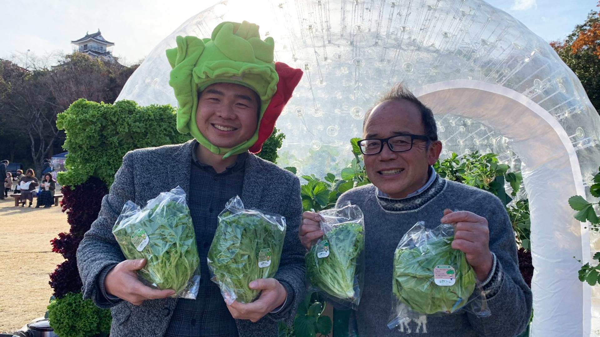 矢野農園の会長さんとマラナタの代表呉徳尚の写真